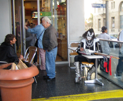 Gene Simmons reading a newspaper