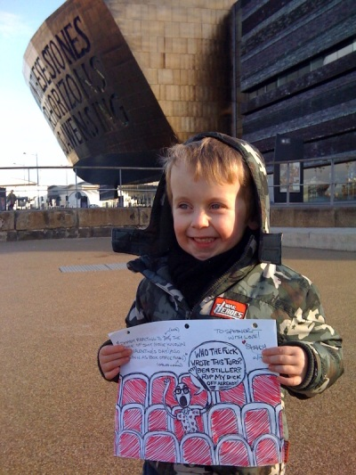 Oscar holding original Justin Shady artwork at Cardiff Bay