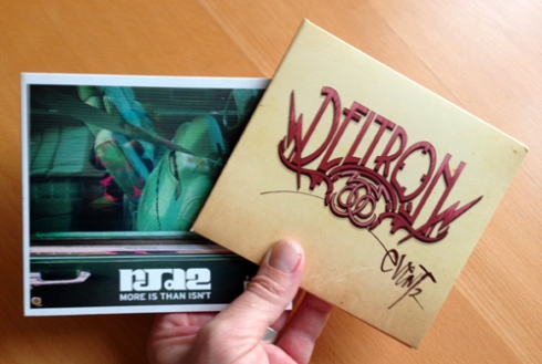 "The last CDs I purchased: ""More Is Than Isn't"" by Rjd2, and ""Event 2"" by Deltron 3030."