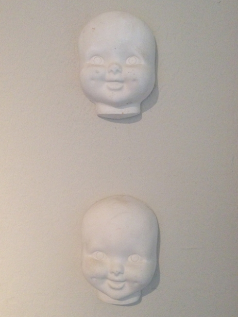 Painted baby doll heads...