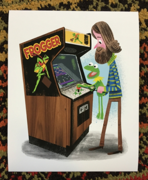 "Luke Flowers' ""Arcade Dayz"" print of Jim Henson and Kermit the Frog playing ""Frogger."""